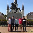 Five men stand in front of statue of Andrew Jackson on horseback