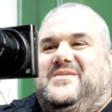 A man holds a camera