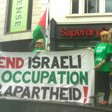 "Four women hold a banner reading ""End Israeli occupation and apartheid!"""