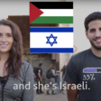 Two people stand side by side with Palestinian and Israeli flags
