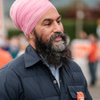 A close-up photo of Jagmeet Singh, seen from chest up, at a rally