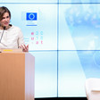 Woman stands at lectern