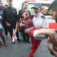 Paramedic carries wounded boy