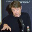 A man talks into a microphone