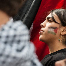 Portrait of girl with flag of Palestine painted on her face