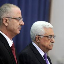 Close-up of profiles of Dr. Rami Hamdallah and Mahmoud Abbas