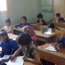 Children sit at school desks