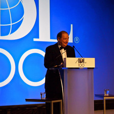 Photo shows Abe Foxman at ADL podium