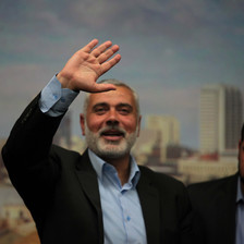 A smiling Ismail Haniyeh waves