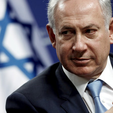 Close-up of Netanyahu with Israeli flag behind him