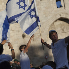 Youths wave Israeli flags in front of the Damascus Gate to Jerusalem's old city