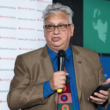 A man holding a microphone and a cell phone