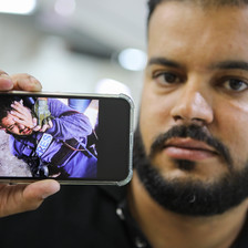 Man holds cellphone with a photograph on it