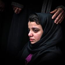 Girl cries dressed in black