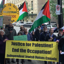 Vancouver demonstrators wave Palestinian flags and hold signs