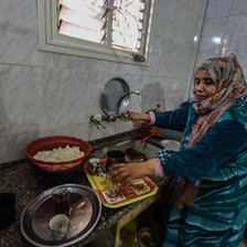 A woman near her kitchen sink