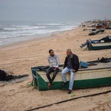 Two men sit on boat