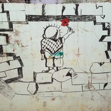 Image of boy holding a flower painted on a wall