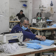 Men sewing protective face masks