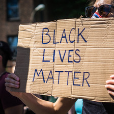 Protester holds sign reading Black Lives matter
