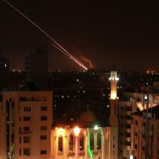 A streak of light from a rocket blazes through a dark sky