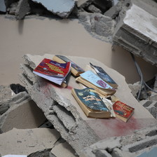 Books amid the rubble of a destroyed building