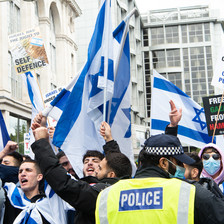 Young people waving Israeli flags and chanting