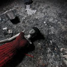 A broken mannequin lies on a floor