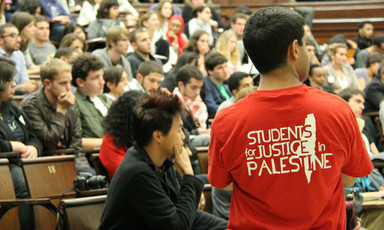 US students watch at a conference on Palestine