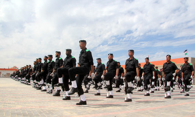 Uniformed men march in formation