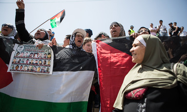 Women chant and carry banners