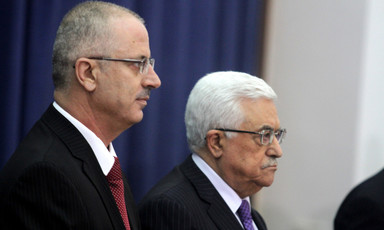 Close-up of profiles of Dr. Rami Hamdallah and Mahmoud Abbas