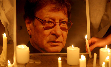 Portrait of Mahmoud Darwish illuminated by candles