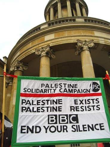 Banner reads: Palestine exists, Palestine resists, BBC end your silence