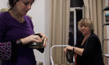 Women handle reels of film