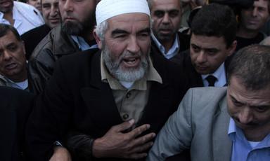 Raed Salah walks through crowd of men