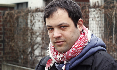 Portrait of young man wearing checkered traditional Palestinian scarf
