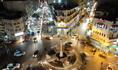 Nighttime aerial view of roundabout at Ramallah's city center