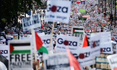 View of hundreds of signs and banners with Gaza and Palestine solidarity messages during massive London protest