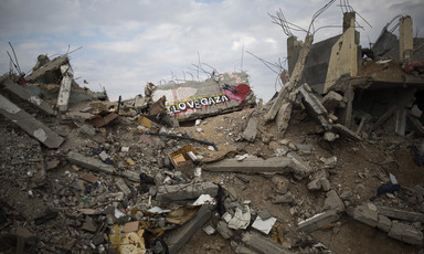 Photo shows I Love Gaza and a heart with a rocket through it spray painted on a pile of rubble