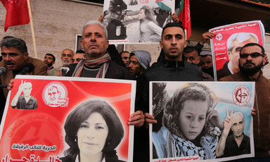 Protesters holding posters of Khalida Jarrar and Ahed Tamimi to show solidarity with Palestinian prisoners held in Israeli jails.