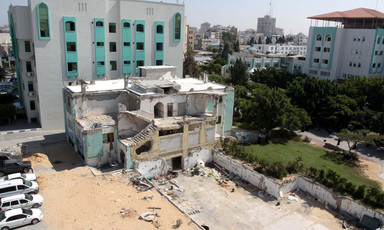 Landscape view of badly damaged multi-story building