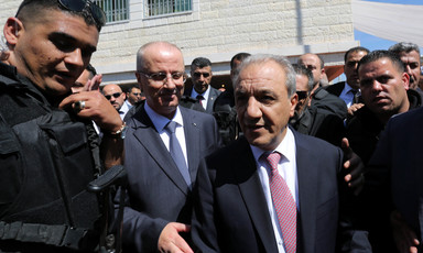 Bodyguards surround Rami Hamdallah and Majid Faraj