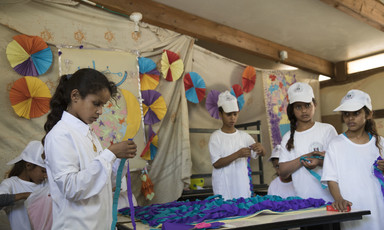 Palestinian schoolchildren making crafts.