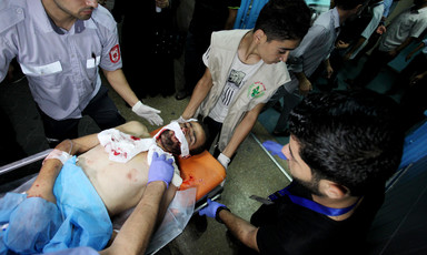 A wounded Palestinian protester is carried on a stretcher.