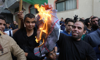 A protestor is seen burning a poster of Avigdor Lieberman, the hardline Israeli politician who resigned over the Israeli response to last week's violence in and around Gaza. The celebratory protests took place outside the home of Hamas leaderIsmail Hani