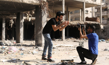 Omar Elemawi films Palestinian rapper Ibrahim Ghunaim (MC Gaza) in front of destroyed buildings in Gaza City