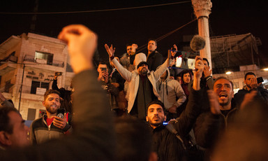 Demonstrators against a new Palestinian social security law chant slogans at Ramallah's central Manara Square