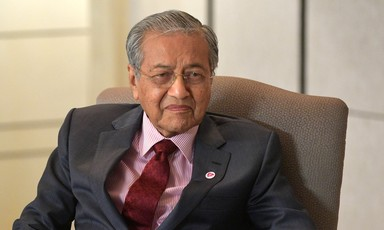 Malaysian Prime Minister Mahathir Mohamad sitting on a chair.