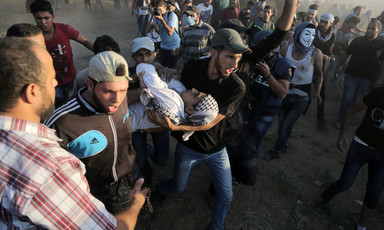 Protesters carry wounded young man